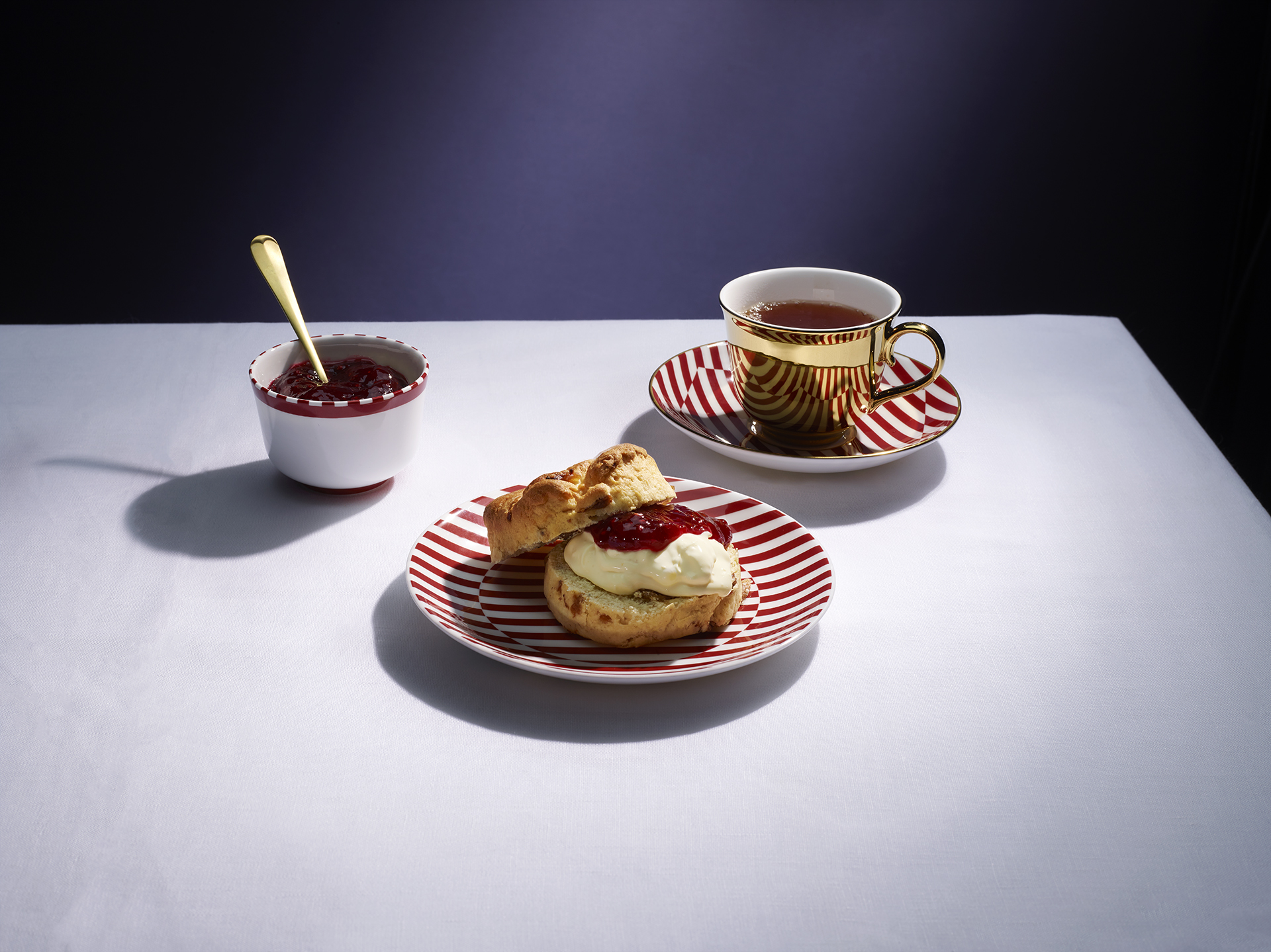 Shot for Richard Brendon Ceramics. This is his Corinthia Red collection, including a plated scone. Food and drink photography by Lauren Mclean